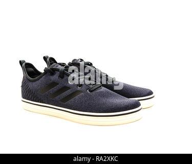 Brand new pair of dark gray men sneaker shoes isolated - Stock Photo