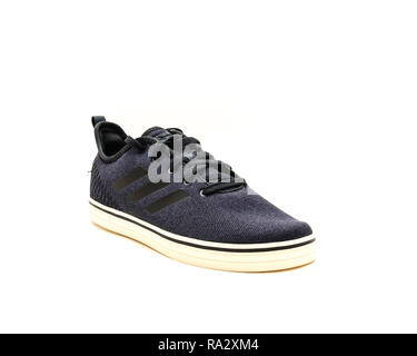 Studio shot brand new dark gray men sneaker shoes isolated - Stock Photo