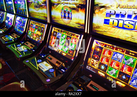 Buffalo, USA-20 July, 2018: Modern casino hall with slot machines, roulette and blackjack tables - Stock Photo