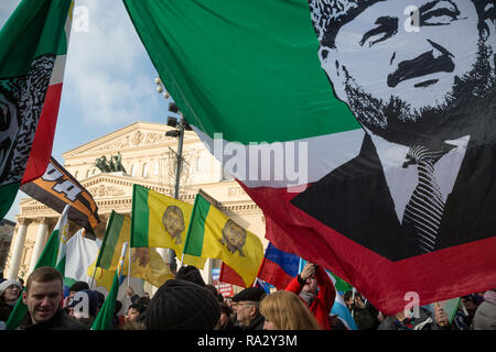 Participants of the March movement 'Anti-Maidan' holding a flag of the Chechen Republic with a portrait of Akhmat Kadyrov in center of Moscow - Stock Photo