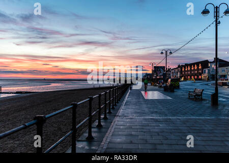 Cleethorpes, Lincolnshire, UK. 31st Dec, 2018. UK Weather: Red sunrise skies in Cleethorpes, Lincolnshire, East Coast, UK. 31st Dec, 2018. Red sky making the perfect backdrop to Cleethorpes Leisure Centre and promenade with partial cloud. Credit: Tommy (Louth)/Alamy Live News - Stock Photo