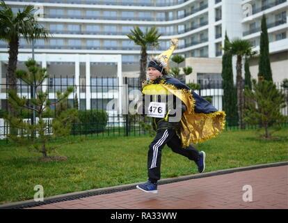 Sochi, Russia. 31st Dec, 2018. SOCHI, RUSSIA - DECEMBER 31, 2018: A boy takes part in a mass run in Imeretinskaya Embankment on New Year's Eve. Artur Lebedev/TASS Credit: ITAR-TASS News Agency/Alamy Live News - Stock Photo