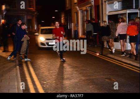 Aberystwyth Wales UK, New Year's Celebrations Dec 31  2018 - January 01 2019  People out on the streets celebrating the start of the new year 2019 in Aberystwyth on the west coast of Wales   photo © Keith Morris / Alamy Live News - Stock Photo