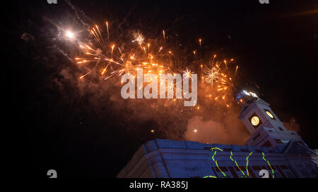 Madrid, Spain. 1st Jan 2019. Hundreds of people gathered at Puerta del Sol in Madrid to welcome the new year 2019. Credit: Lora Grigorova/Alamy Live News - Stock Photo