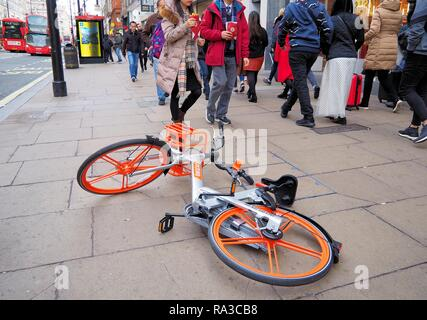London, UK. 1st Jan 2019.London's Oxford Street sees the return of Mobikes littering the pavement and causing obstruction to pedestrians. Credit: Brian Minkoff/Alamy Live News - Stock Photo
