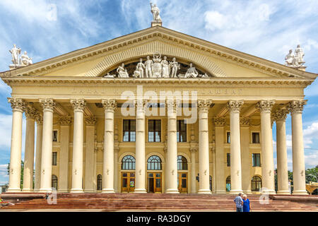 Minsk, Belarus, June 28th 2018 - A government building with flowers and people in Minsk