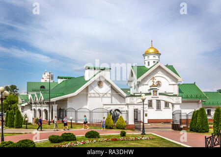 Minsk, Belarus, June 28th 2018 - An orthodox church with green roof and golden dome with a garden and people in front of it in Minsk - Stock Photo
