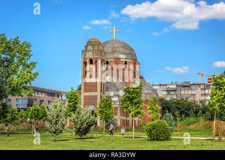 Pristina, Kosovo - May 30th 2018 - A huge orthodox church in a open grass field in Kosovo - Stock Photo