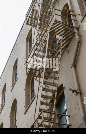 A fire escape is on the side of an old building in downtown SPokane, Washington. - Stock Photo