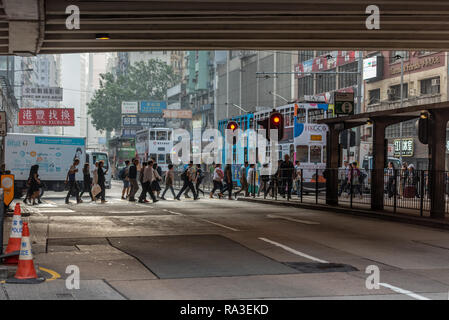 A typically busy crossing on Hennessy Road at Canal Road West in Hong Kong's Causeway Bay - Stock Photo