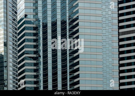 The zig-zag patterns of the windows of the JW Marriott Hotel at Pacific Place on Hong Kong island, flanked by the Conrad Hotel and One Pacific Place - Stock Photo