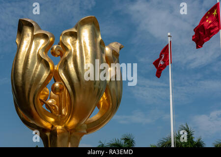 The 'Forever Blooming Golden Bauhinia Sculpture' which lends its name to Golden Bauhinia Square at Hong Kong's Convention and Exhibition Centre - Stock Photo