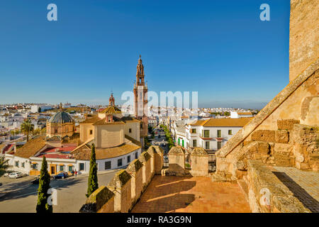 CARMONA SPAIN A  VIEW FROM FORTRESS OF THE GATE OF SEVILLE OVER THE TOWN AND CHURCH TOWER SIMILAR TO THE GIRALDA BELL TOWER Stock Photo