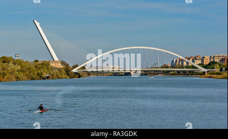 SEVILLE SPAIN THE BARQUETA BRIDGE ON THE BANKS OF THE GUADALQUIVIR RIVER WITH THE PYLON OF THE ALAMILLO BEHIND - Stock Photo