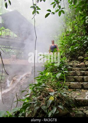 A middle aged woman exploring natural thermal volcanic hot springs in the jungles of Honduras - Stock Photo