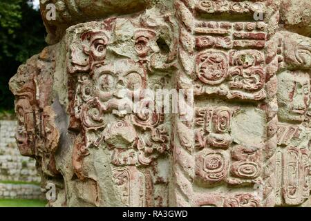 Carved stone pillars in Mayan ruins in the jungles of Honduras - Stock Photo