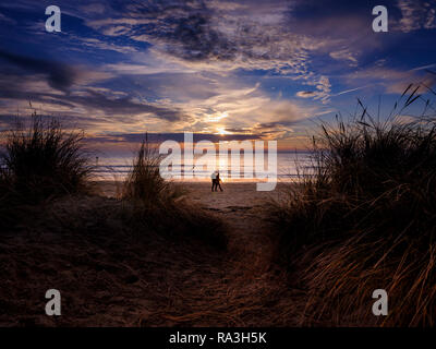 Sunset beyond sand dunes on West Wittering beach near Chichester, West Sussex. - Stock Photo