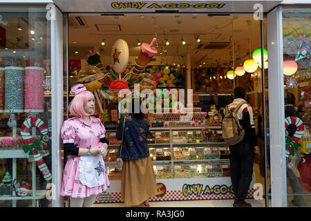 Girl in a maid costume in front of a candy shop in Harajuku, Tokyo, Japan - Stock Photo