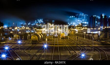Railway tracks with freight trains, freight station at night, Godorf, Cologne, North Rhine-Westphalia, Germany - Stock Photo