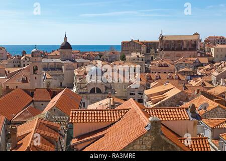 View from the city wall onto roofs of the old town with cathedral, St. Blasius church and Jesuit monastery, Dubrovnik, Croatia - Stock Photo