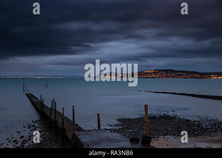 Jetty at Rhos-on-Sea at night on the North Wales coast - Stock Photo