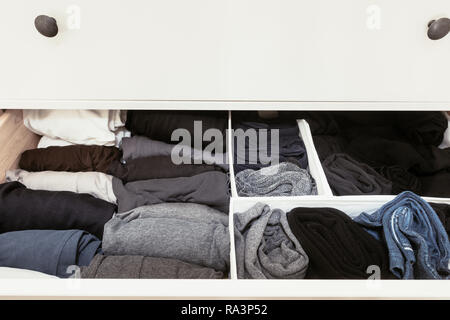 organised clothes in a drawer - Stock Photo