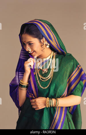A PORTRAIT OF A MARATHI/MAHARASHTRIAN Bride LAUGHING, dressed in traditional SAREE - Stock Photo