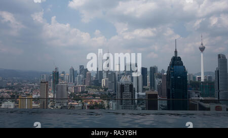 View over Kuala Lumpur, Malaysia with hazy sky - Stock Photo