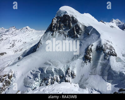 Breithorn mountain seen from Klein Matterhorn in Zermatt ski region, Switzerland - Stock Photo
