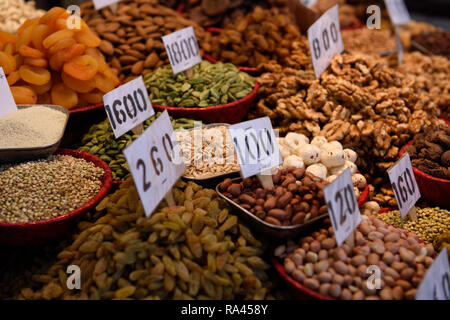 Assorted fresh dried fruits, nuts, and seeds in the Khari Baoli spice market in Old Delhi, India