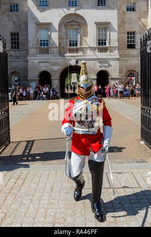 Soldier of the mounted regiment, the Household Cavalry Mounted Regiment, changing of the guard in front of the Horse Guard - Stock Photo