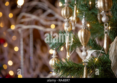 New Year 2019. Christmas beautiful lights bokeh on gold warm background. Defocused Lights on a Tree Background. Christmas tree toys. Golden abstract b - Stock Photo