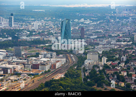 East Frankfurt, aerial view to south-west area Sachsenhausen district and Frankfurt airport in the background. European Central Bank in foreground. - Stock Photo