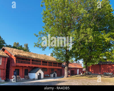 Traditional red wooden houses in Old Town Orebro (Gamla Orebro), Orebro, Närke, Sweden - Stock Photo