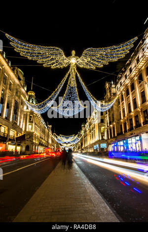 Regents Street Christmas lights in London, taken at dusk, early evening around Christmas 2018 - Stock Photo