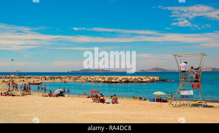 Marseilles, France, holidaymakers on one of the Mediterranean's beaches, Provence - Stock Photo