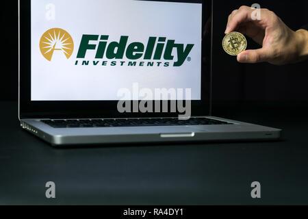 Bitcoin coin with the Fidelity logo on a laptop screen, Slovenia - December 23th, 2018 - Stock Photo
