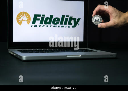 Monero coin with the Fidelity logo on a laptop screen, Slovenia - December 23th, 2018 - Stock Photo
