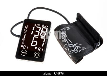 Blood pressure monitor, digital display, upper arm cuff, for self-measurement - Stock Photo