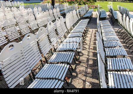 Baden-Baden, in the Black Forest, white chairs, rows of chairs in the spa garden von der Konzertmuschel, Baden-Baden - Stock Photo