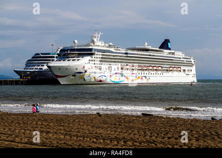 Cruise ships at the pier in Puntarenas, Puerto Caldera, Costa Rica. NCL's Norwegian Star in foreground. - Stock Photo