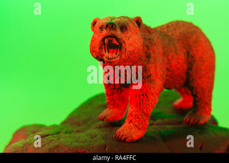 Toy bear standing on rock against plain background, all colour lit. Metaphor bear market, market bears, Stock Market bearish,being bearish. - Stock Photo