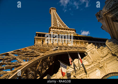 A replica iron Eiffel Tower stands above the Paris Las Vegas hotel and casino on the Strip, in Las Vegas, Nevada. - Stock Photo