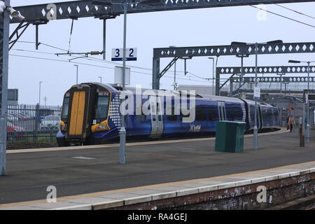 A ScotRail class 380 EMU waits in Gourock platform 3 about to work a a stopping service to Glasgow Central. - Stock Photo