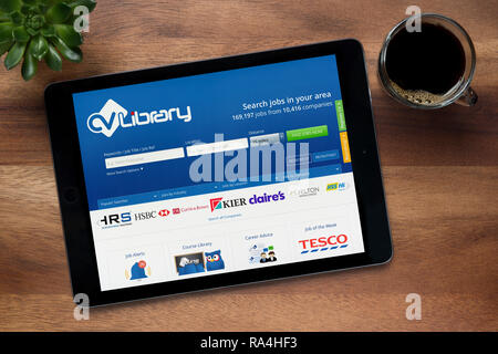 The Cv Library Website On An Ipad Tablet Device Which Rests On A