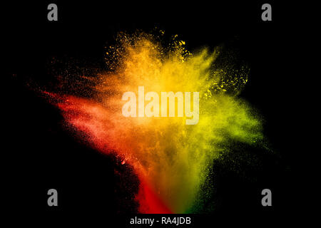 Bizarre forms of powder painted and flour combined explode in front of a black background to give off fantastic colors and forms. - Stock Photo