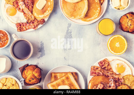 Healthy Full American Breakfast with Eggs Bacon Pancakes and Latkes, top view. - Stock Photo