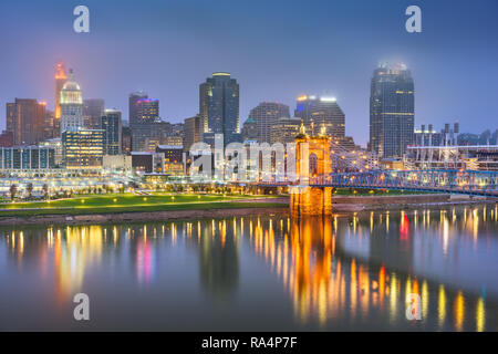 Cincinnati, Ohio, USA skyline on the river at night. - Stock Photo