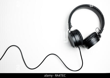 Black headphones isolated on the white background - Stock Photo
