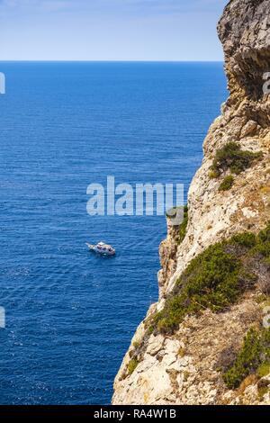Alghero, Sardinia / Italy - 2018/08/11: Panoramic view of the Gulf of Alghero with cliffs of Cape Cappo Caccia over the Neptune`s Grotto - Stock Photo